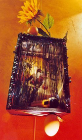 APACHE, SUR UN VELO, ALLANT AU MONDE DES OEUFS: Collaged lamp box with hollowed egg frame and curtains, $450