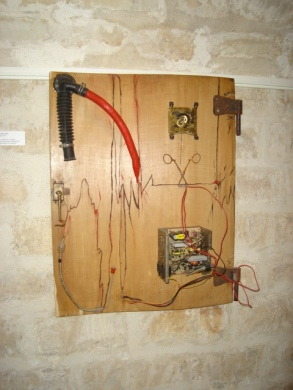 IN THE PASSED: Oil painted and mechanical parts on an armoir door, $340