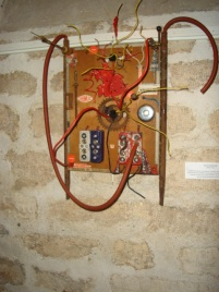 OHMIC STAR: Electric circuitry mounted on wood frame. $250