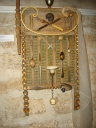 REMISSION: Antique washboard with chandelier fragments and vintage cutlery. A veiled wedding promise, $800