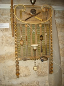 REMISSION: Antique washboard with chandelier fragments and vintage cutlery. A veiled wedding promise, $550