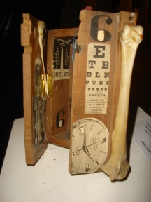 SIX: Antique phone box with bones and collage, SOLD